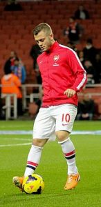 Jack_Wilshere_warm_up_-_12_Feb_2014_(cropped)